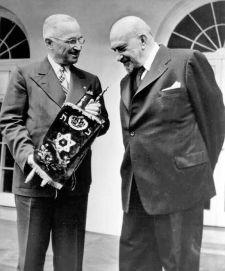 President Harry Truman receives a Torah Scroll from Dr. Chaim Weizmann.