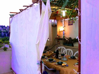 Canvas-sided sukkah on a roof in Jerusalem.