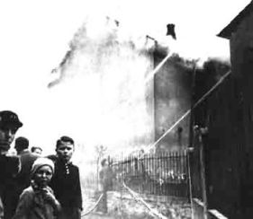 12_Burning synagogue on Kristallnacht in Nazi-Germany, November 10, 1938.