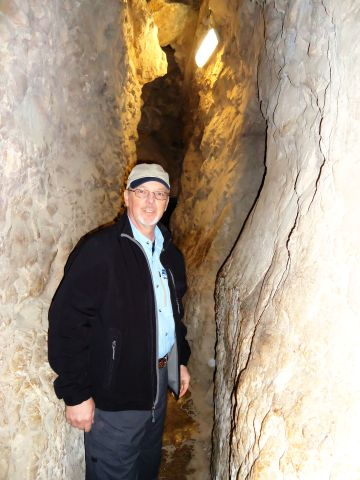 Charles E. McCracken enters the Canaanite Tunnel Walkway